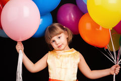 Caucasian blond little girl with colorful balloons Royalty Free Stock Images