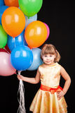 Caucasian blond little girl with colorful balloons Royalty Free Stock Photos