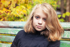 Caucasian blond teenage girl in black jacket Royalty Free Stock Image