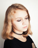 Caucasian blond teenage girl with closed eyes Stock Photos