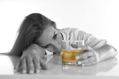 Caucasian blond wasted and depressed alcoholic woman drinking scotch whiskey glass messy drunk. Caucasian blond wasted and depressed alcoholic woman drinking Royalty Free Stock Photography