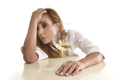 Caucasian blond wasted and depressed alcoholic woman drinking white wine glass desperate drunk Royalty Free Stock Photography