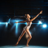 Caucasian blonde ballerina posing on stage Stock Photos