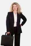 Caucasian blonde business woman. Carrying briefcase Royalty Free Stock Images