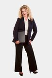 Caucasian blonde business woman. Carrying laptop Stock Image