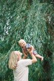 Caucasian blonde mother holding hugging baby boy Stock Photos