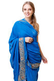 Caucasian young woman in blue indian national dress isolated Stock Photos