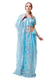 Caucasian young woman in blue indian national dress isolated Royalty Free Stock Photo