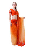 Caucasian young woman in red indian national dress isolated. Caucasian blonde smiling girl in red indian national dress sari in studio on white background Stock Photo