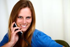 Caucasian blonde woman on phone smiling Royalty Free Stock Image