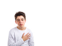 Caucasian boy with acne-prone skin keeping his right hand on the Royalty Free Stock Photo