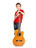 Caucasian boy with acoustic guitar Royalty Free Stock Images