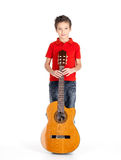 Caucasian boy with acoustic guitar Stock Photos