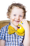 Young boy holding chocolate egg Stock Images