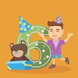 Caucasian boy celebrating sixth birthday. Caucasian boy standing next to the number six, gift box and teddy bear at birthday party. Six years old boy wearing Stock Images