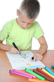Caucasian boy drawing on paper with crayons Royalty Free Stock Photos