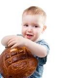 A  Caucasian boy eating a bread Royalty Free Stock Photos