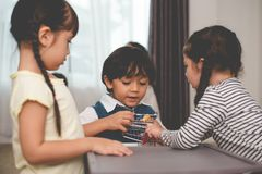 Caucasian boy fighting for toys with her sisters. Family and chi stock photography