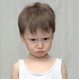 Caucasian boy in a gloomy mood Stock Image