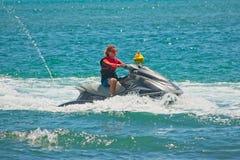 Maroochydore, Qld, Australia - March 10, 2019: Teenager riding a jetski. Caucasian boy having fun riding a jetski on the Sunshine Coast stock photos