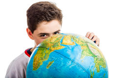 Caucasian boy hidden behind globe Royalty Free Stock Images