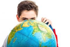 Caucasian boy hidden behind globe Stock Image