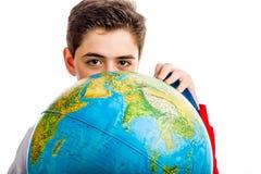 Caucasian boy hidden behind globe Royalty Free Stock Photos
