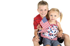 Caucasian boy holding blond blue eyed girl with Am Royalty Free Stock Photo