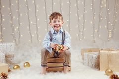 Caucasian boy holding ornament ball toy celebrating Christmas or New Year Stock Image