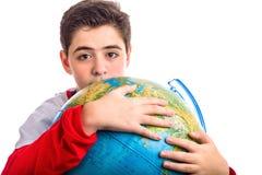 Caucasian boy hugs globe Royalty Free Stock Images