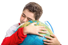 Caucasian boy hugs globe smiling Royalty Free Stock Photos