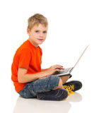 Caucasian boy laptop Stock Photography