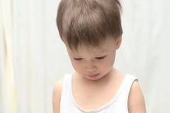 Caucasian boy looking down Stock Image