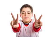 Caucasian boy making victory sign with both hands Royalty Free Stock Photos