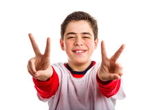 Caucasian boy making victory sign with both hands Stock Photo