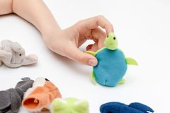 A caucasian boy playing finger puppets, toys, dolls - figures of animals, heroes of the puppet theatre put on fingers of human. Hand stock photography