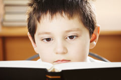 Caucasian boy reading book closeup Royalty Free Stock Images