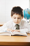 Caucasian boy reading book Stock Photography
