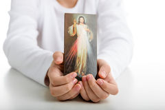 Caucasian boy showing  Merciful Jesus icon Stock Photos