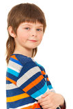Caucasian boy standing with his arms folded royalty free stock image