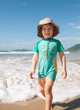 Caucasian boy walking on the beach Stock Images