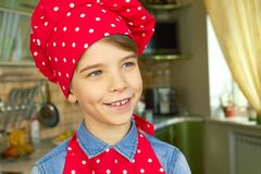 Caucasian boy wearing chef hat. Cute kid smiling Royalty Free Stock Photo