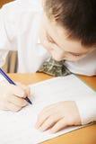 Caucasian boy writing closeup Stock Photos