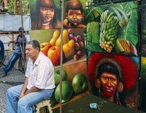 Caucasian Brazilian man selling local Braziilan scenes illustrat royalty free stock photography
