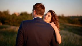 Caucasian bride and groom posing in the field stock video