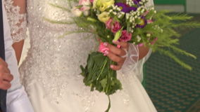 Caucasian Bride in Lacy White with Bouquet in Mosque in Saigon stock video footage