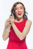 Caucasian Brunette Girl  Holding Artistic Spectacles In Front Of Face. Portrait of Astonished Caucasian Brunette Girl  Holding Artistic Spectacles In Front Of Stock Image