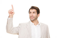 Caucasian brunette happy business man pointing finger isolated on white Royalty Free Stock Photo