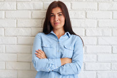 Caucasian brunette with thoughtful pleased facial expression Stock Photography