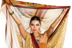 60100308a2 Caucasian brunette woman in brown indian national dress sari. In studio on white  isolated background
